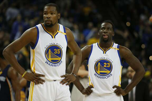 Kevin Durant (35) and Draymond Green (23) of the Golden State Warriors are seen on court during the second quarter of their game against the Memphis Grizzles at Oracle Arena in Oakland, Calif. Friday, Jan. 6, 2017.