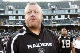 Oakland Raiders head coach Tom Cable walks off the field after an NFL football game against the Baltimore Ravens in Oakland, Calif., Sunday, Jan. 3, 2010. The Ravens won 21-13. (AP Photo/Paul Sakuma)