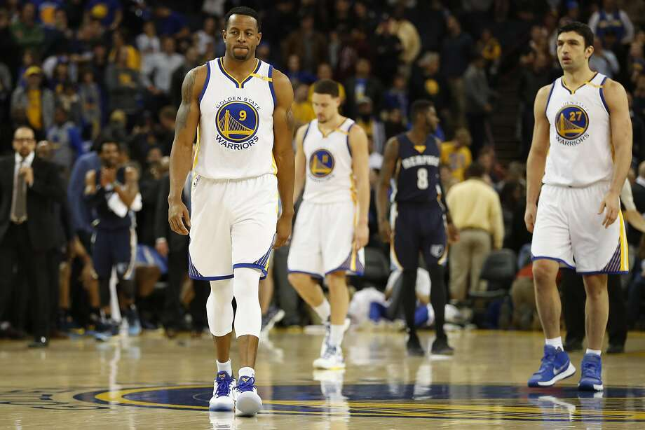 Andre Iguodala (9), Klay Thompson (11) and Zaza Pachulia (27) of the Golden State Warriors walks on the court during overtime against the Memphis Grizzles at Oracle Arena in Oakland, Calif. on Friday, Jan. 6, 2017. The Grizzles defeated the Warriors 128-119. Photo: Stephen Lam, Special To The Chronicle