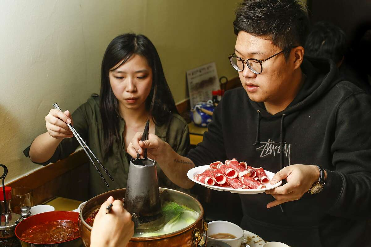 Xuejiao Hu (left), visiting from Lanzhou, China and Seung Yeon Kim (right), originally from South Korea, now living in San Francisco at Boiling Beijing, a Beijing-style restaurant whose main specialty is hot pot, served in traditional pots with a conical center vent in San Bruno, California on Friday January 6, 2017.