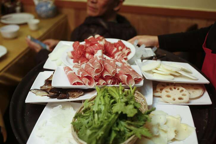 A tray of meats and vegetables for hot pot cooking at Boiling Beijing, a Beijing-style restaurant whose main specialty is hot pot, served in traditional pots with a conical center vent in San Bruno, California on Friday January 6, 2017.