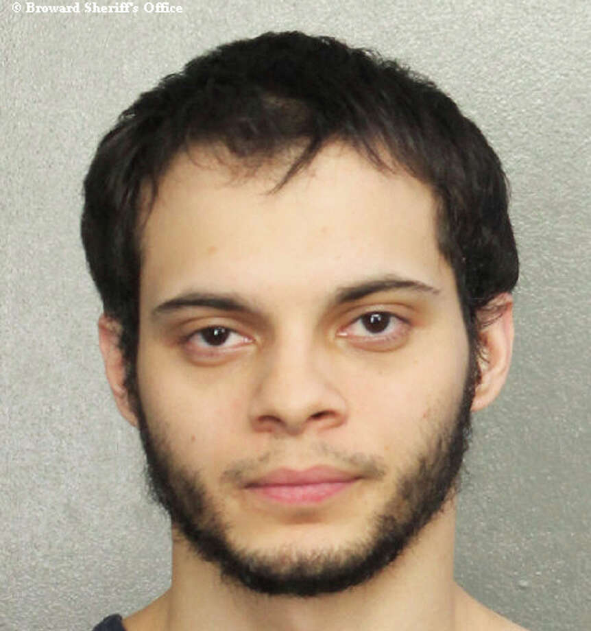 This booking photo provided by the Broward Sheriff's Office shows suspect Esteban Ruiz Santiago, 26, Saturday, Jan. 7, 2017, in Fort Lauderdale, Fla. Relatives of the man who police say opened fire Friday killing several people and wounding others at a Florida airport report he had a history of mental health issues. They tell The Associated Press and other news outlets that some of the problems followed his time serving a military tour in Iraq, and that he was being treated at his current home in Alaska. (Broward Sheriff's Office via AP) Photo: Broward Sheriff's Office/AP
