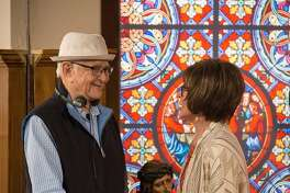 "Norman Lear and cast member Rita Moreno on the set of ""One Day at a Time,"" now available for streaming on Netflix"