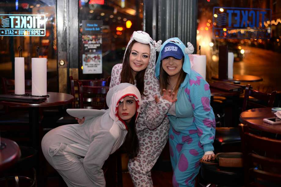 One of the best ways to beat the cold is a warm pair of pajamas, vigorous walking and multiple alcoholic drinks. Area residents put this to the test Friday night, Jan. 7, 2017, during the Onesie Pub Crawl. Photo: By Kody Melton, For MySA