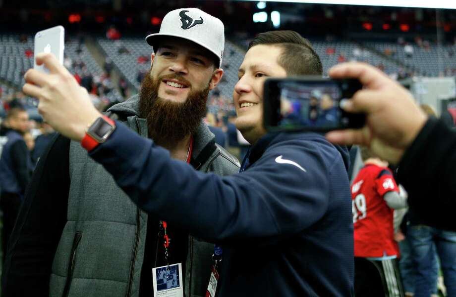 Houston Astros pitcher Dallas Keuchel takes a photo with a fan before an AFC Wild Card Playoff game at NRG Stadium on Saturday, Jan. 7, 2017, in Houston. Photo: Brett Coomer, Houston Chronicle / © 2017 Houston Chronicle