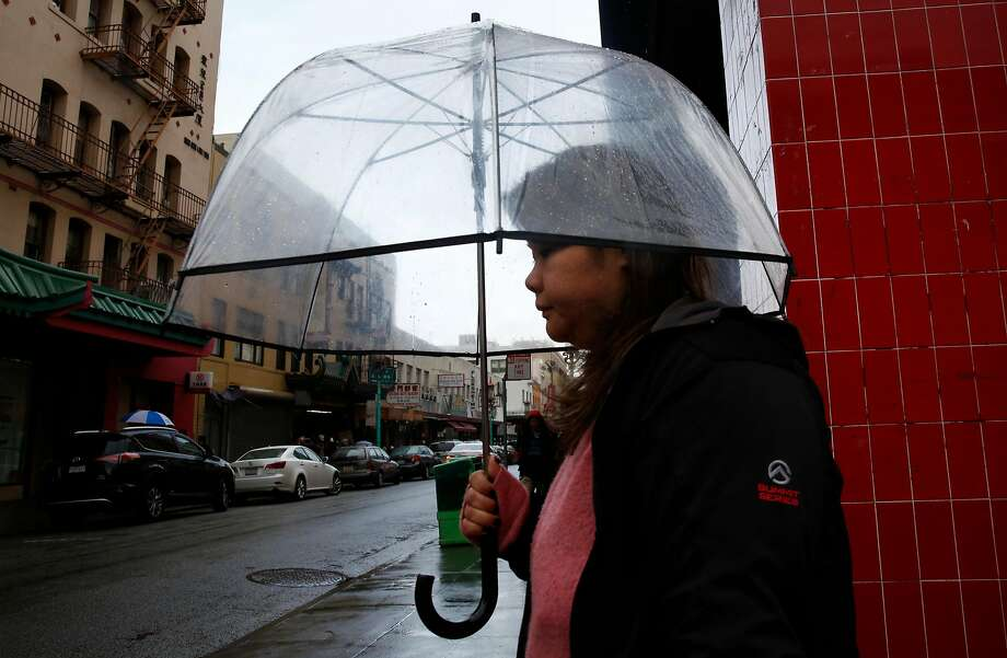 A pedestrian tries to stay dry in Chinatown Jan. 7, 2017 in San Francisco, Calif. Photo: Leah Millis, The Chronicle