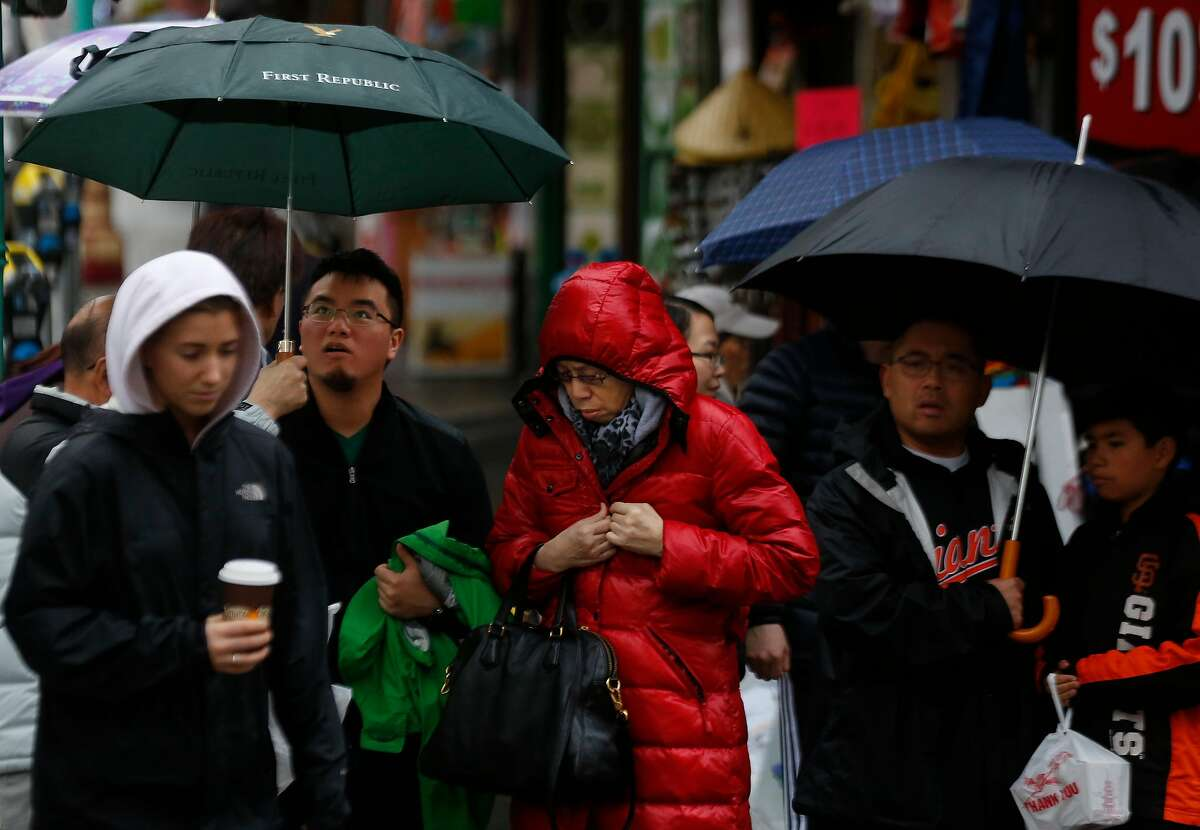 People prepare to cross the street in Chinatown Jan. 7, 2017 in San Francisco.