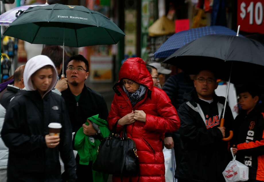 People prepare to cross the street in Chinatown Jan. 7, 2017 in San Francisco, Calif. Photo: Leah Millis, The Chronicle