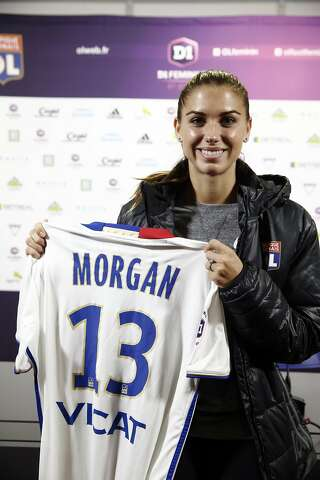 6ad2b4b160a United States  Alex Morgan holds us her new shirt during a press conference  as part