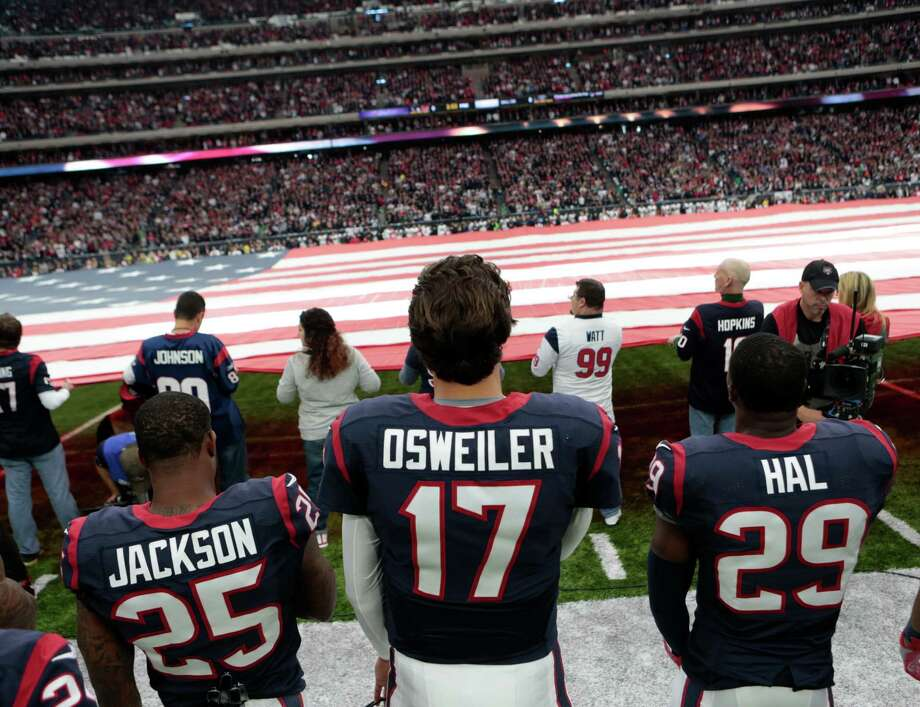 Houston Texans cornerback Kareem Jackson (25), quarterback Brock Osweiler (17) and free safety Andre Hal (29) are seen during the National Anthem before an AFC Wild Card Playoff game at NRG Stadium on Saturday, Jan. 7, 2017, in Houston. Photo: Brett Coomer, Houston Chronicle / © 2017 Houston Chronicle