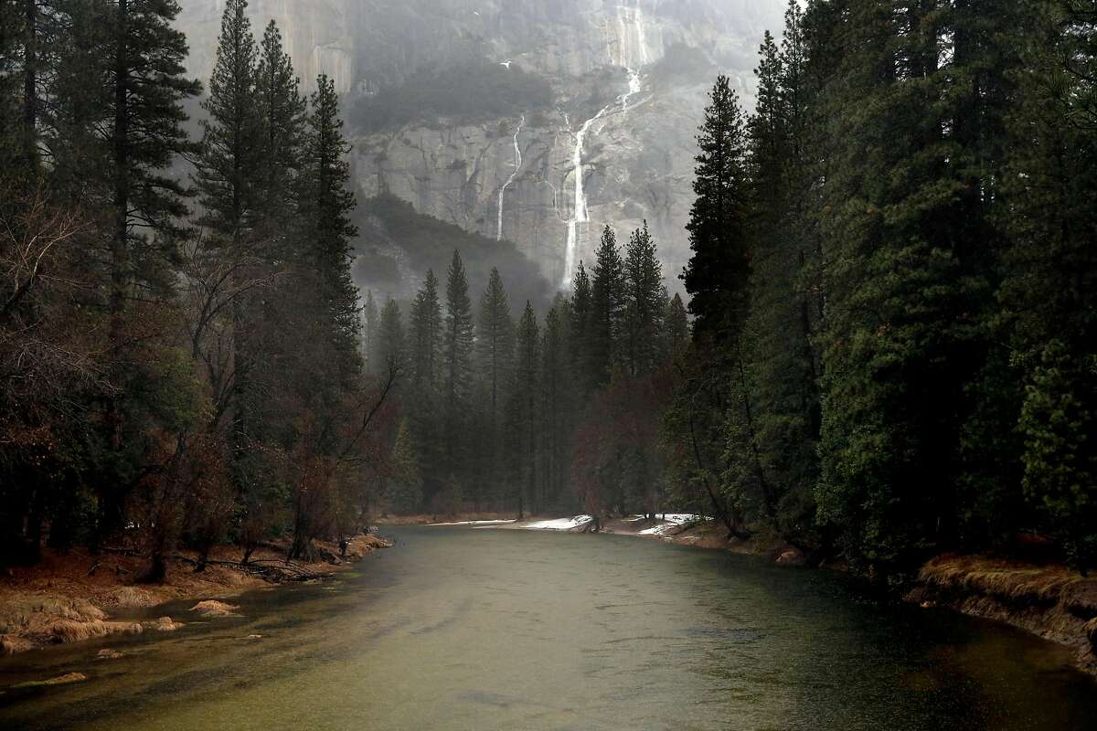 Water streams down the easts side of El Capitan into the Merced River in Yosemite National Park, Ca., on Saturday Jan. 7, 2017, as heavy rain begins to fall.