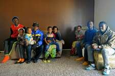 Congolese refugees of the Byamukama Zadoki family pose for a photo Saturday, Jan. 7, 2017, in their apartment home.  James Durbin/Reporter-Telegram
