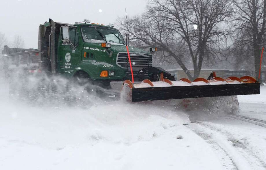 A Norwalk Department of Public Works snow plow cleans King Street during the snow storm Saturday, January 7, 2017, in Norwalk, Conn. Photo: Erik Trautmann, Hearst Connecticut Media / Norwalk Hour