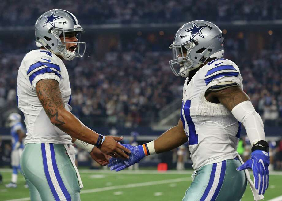 Dallas Cowboys quarterback Dak Prescott (4) celebrates the touchdown run by Dallas Cowboys running back Ezekiel Elliott (21) in the first quarter as the Cowboys take on the Detroit Lions Monday, Dec. 26, 2016 in AT&T Stadium in Arlington, Texas. (Richard W. Rodriguez/Fort Worth Star-Telegram/TNS) Photo: Richard W. Rodriguez, MBR / Fort Worth Star-Telegram