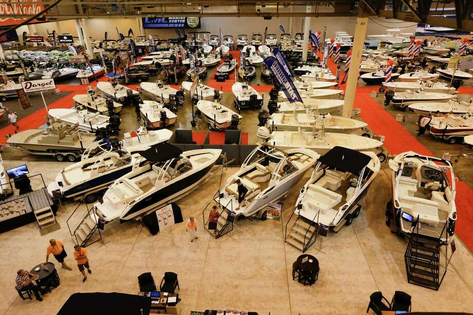 While more than 1,000 watercraft, from paddle boards to luxury cruisers, are the main attractions of the Houston Boat Show, at NRG Center through Jan. 15, the event also offers anglers opportunity to visit with guides, outfitters and others. Photo: James Nielsen / © 2016 Houston Chronicle