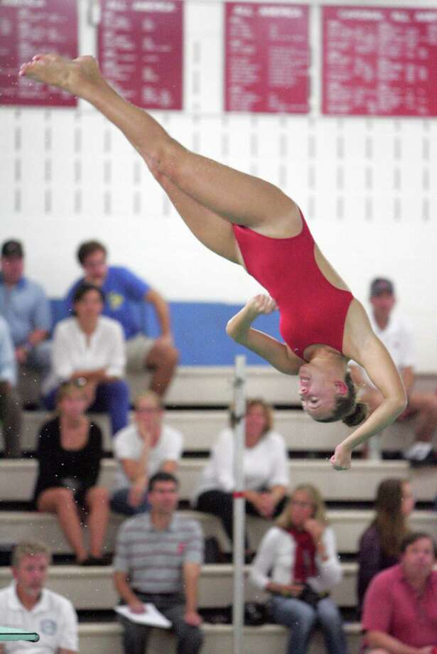 Greenwich's Kate Russack dives against Wilton during a meet in Octover in Greenwich. Russack was named the state's diver of the year. Photo: Matthew Brown / For Hearst Connecticut Media / Connecticut Post Freelance