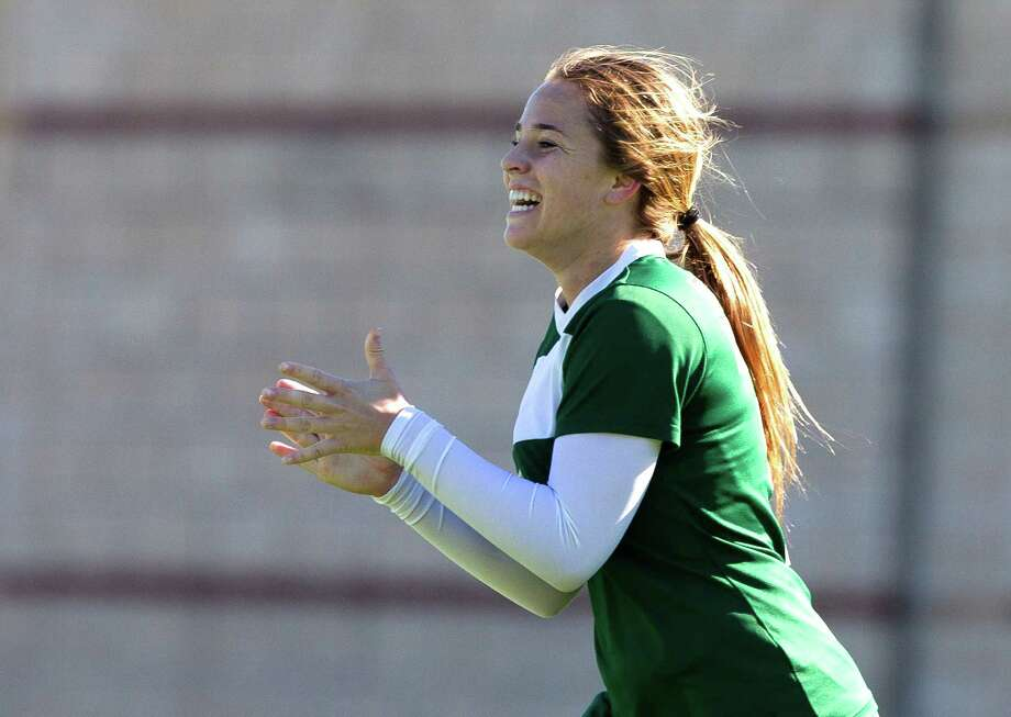 The Woodlands' Ana Helmert (5) celebrates after scoring a goal past Round Rock Westwood keeper Remy Corbin (1) in the first period of a high school girls soccer match during the Lady Highlander Invitational at Woodforest Bank Stadium Saturday, Jan. 7, 2017, in Shenandoah. The Woodlands played Round Rock Westwood to a 2-2 draw. Photo: Jason Fochtman, Staff Photographer / Houston Chronicle