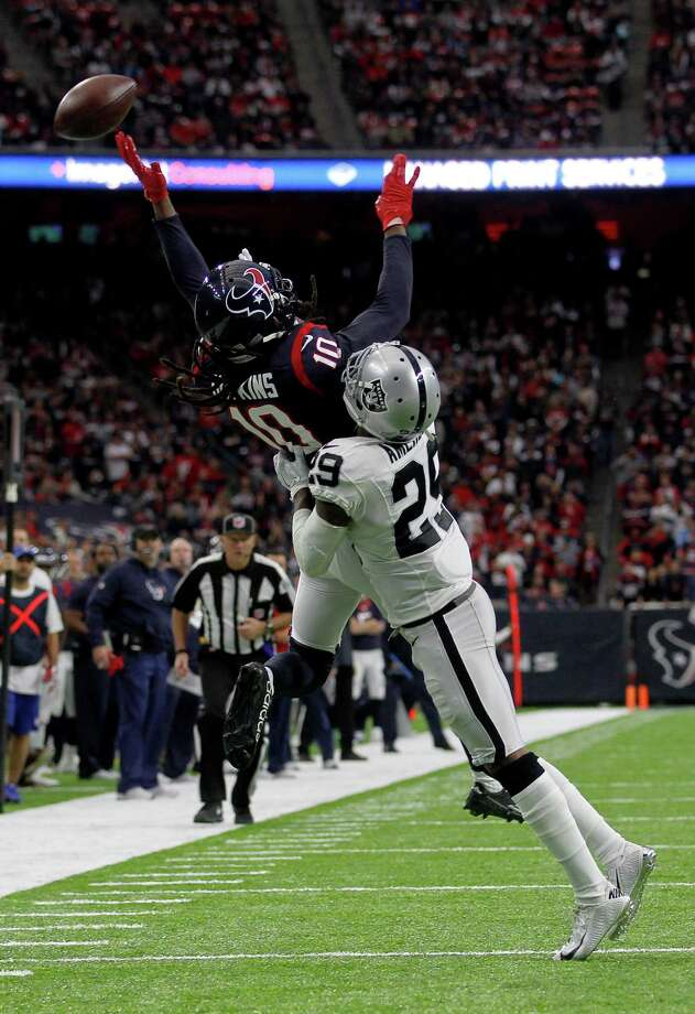 Houston Texans wide receiver DeAndre Hopkins (10) misses a pass under pressure from Oakland Raiders cornerback David Amerson (29) during the second quarter of an AFC Wild Card Playoff game at NRG Stadium Saturday, Jan. 7, 2017, in Houston. Photo: Jon Shapley, Houston Chronicle / © 2015  Houston Chronicle