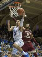 Duke's Jayson Tatum (0) attempts a layup as Boston College's Mo Jeffers (15) defends during the second half of an NCAA college basketball game in Durham, N.C., Saturday, Jan. 7, 2017. Duke defeated Boston College 93-82. (AP Photo/Ben McKeown)