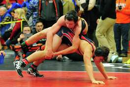 Shelton's David Brown, top, works to topple Middletown's Max Cyr during Fairfield Warde Invitational wrestling tournament action in Fairfield, Conn. on Saturday Jan. 7, 2017.