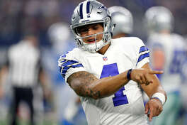 Dallas Cowboys' Dak Prescott gestures during an NFL football game against the Detroit Lions on Monday, Dec. 26, 2016, in Arlington, Texas. (AP Photo/Brandon Wade)