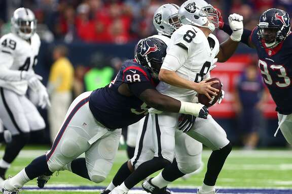 Oakland Raiders quarterback Connor Cook (8) is sacked by Houston Texans defensive end D.J. Reader (98) during the first quarter of an AFC Wild Card Playoff game at NRG Stadium Saturday, Jan. 7, 2017, in Houston. ( Jon Shapley / Houston Chronicle )