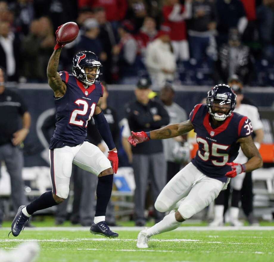 Houston Texans cornerback A.J. Bouye (21) reacts after intercepting a pass by Oakland Raiders quarterback Connor Cook (8) during the fourth quarter of an NFL playoff game at NRG Stadium, January 7, 2017. Photo: Karen Warren, Houston Chronicle / 2016 Houston Chronicle