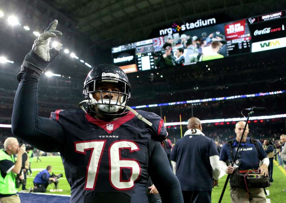 Houston Texans tackle Duane Brown (76) waves to the fans as he leaves the field after the Texans 27-14 win over the Oakland Raiders in an AFC Wild Card Playoff game at NRG Stadium on Saturday, Jan. 7, 2017, in Houston. Photo: Brett Coomer, Houston Chronicle / © 2017 Houston Chronicle
