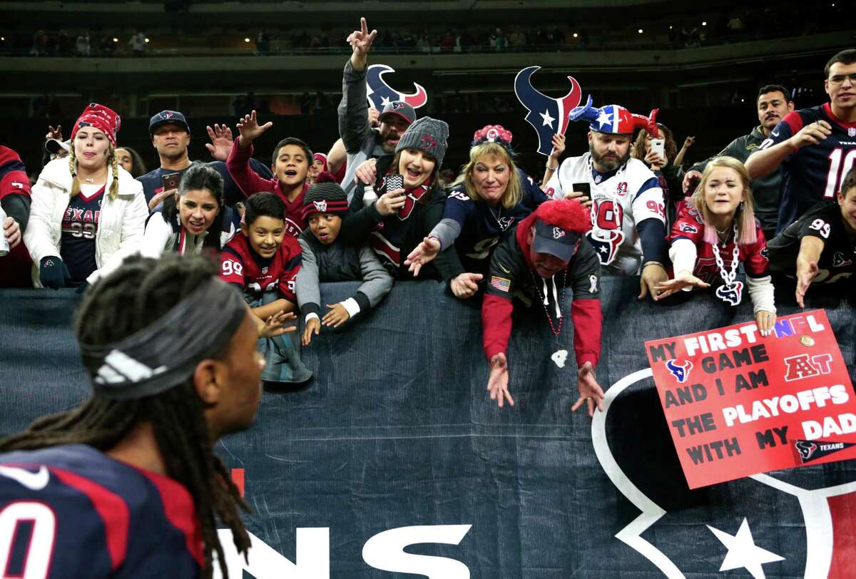 Houston Texans fans cheer as Houston Texans wide receiver DeAndre Hopkins (10) walks off the field after the Texans' 27-145 win over the Oakland Raiders in an AFC Wild Card Playoff game at NRG Stadium on Saturday, Jan. 7, 2017, in Houston.