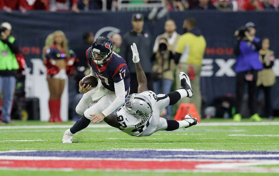 Houston Texans quarterback Brock Osweiler (17) scrambles for a first down against Oakland Raiders defensive end Mario Edwards (97) during the first half of an AFC Wild Card NFL football game Saturday, Jan. 7, 2017, in Houston. (AP Photo/Eric Gay) Photo: Eric Gay, STF / Copyright 2017 The Associated Press. All rights reserved.