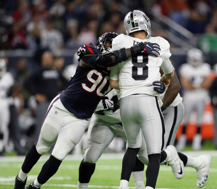 Houston Texans defensive end Jadeveon Clowney (90) nearly sacks Oakland Raiders quarterback Connor Cook (8) during the fourth quarter of an NFL playoff game at NRG Stadium, January 7, 2017. Photo: Karen Warren, Houston Chronicle / 2016 Houston Chronicle
