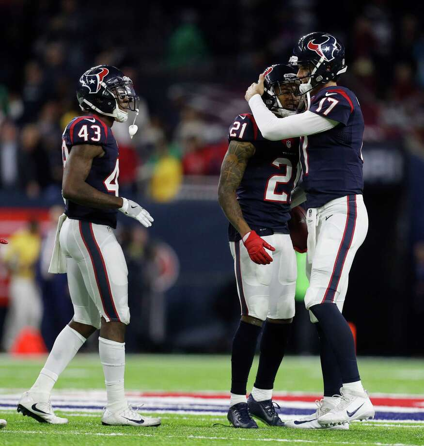 Houston Texans cornerback A.J. Bouye (21) gets a hug from quarterback Brock Osweiler (17) after intercepting a pass by Oakland Raiders quarterback Connor Cook (8) during the fourth quarter of an NFL playoff game at NRG Stadium, January 7, 2017. Photo: Karen Warren, Houston Chronicle / 2016 Houston Chronicle