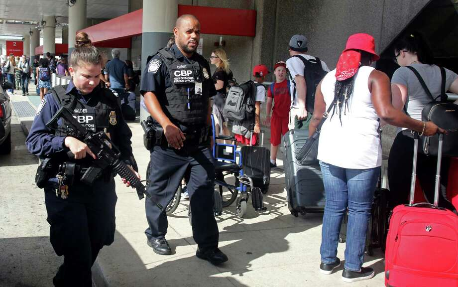 There was a heavy police presence at the Fort Lauderdale-Hollywood International Airport after it re-opened Saturday. Investigators continued their work in the baggage area of terminal 2 the day after a lone gunman killed five people and wounded six. Photo: Mike Stocker, MBO / Sun Sentinel 2016