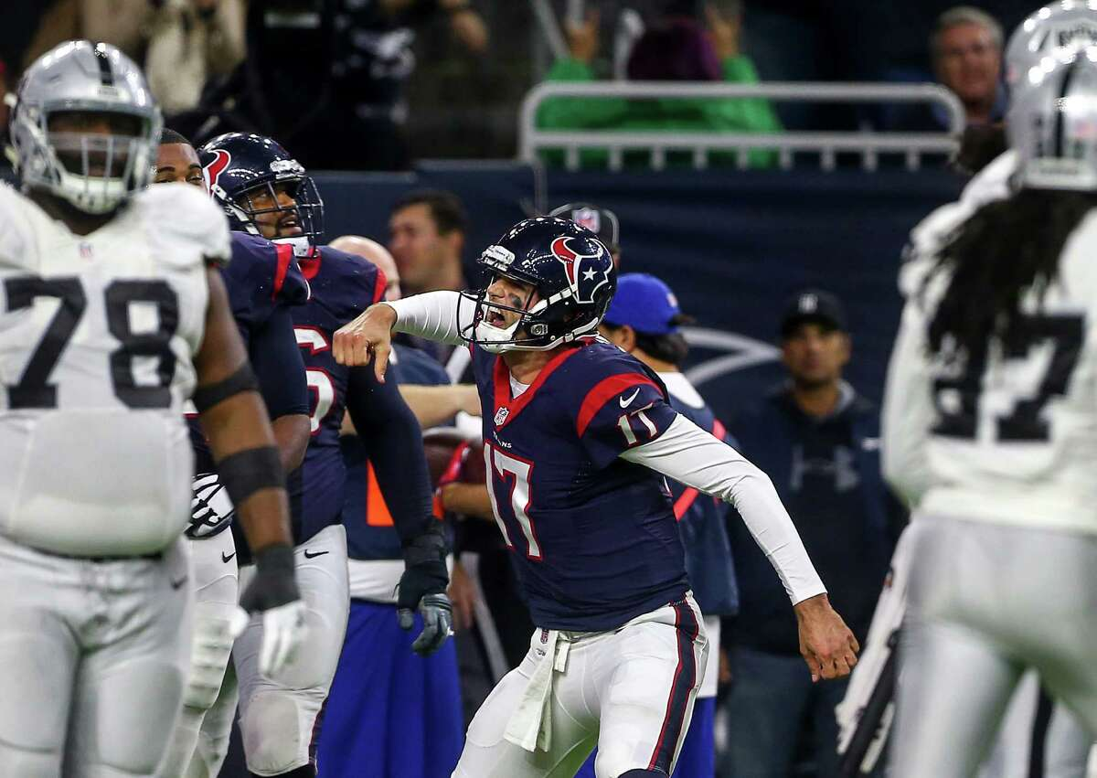 Houston Texans quarterback Brock Osweiler (17) celebrates after rushing for a touchdown during the fourth quarter of an AFC Wild Card Playoff game at NRG Stadium Saturday, Jan. 7, 2017, in Houston.