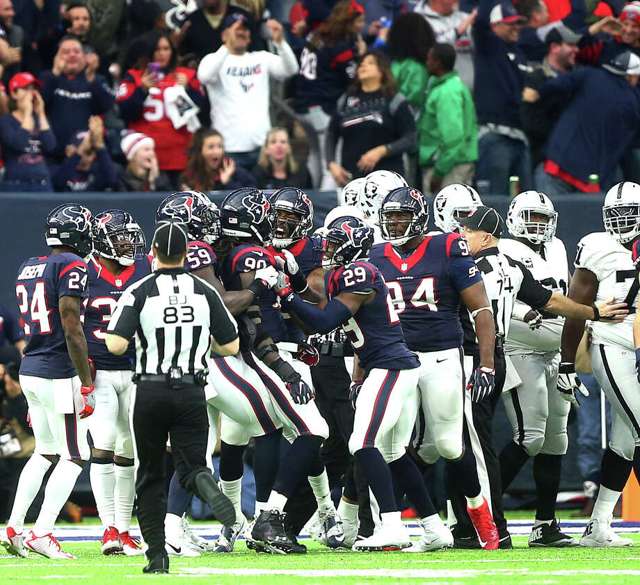Houston Texans defensive end Jadeveon Clowney (90) is congratulated by teammates for an interception during the first quarter of an AFC Wild Card Playoff game at NRG Stadium Saturday, Jan. 7, 2017, in Houston. Photo: Jon Shapley, Houston Chronicle / © 2015  Houston Chronicle