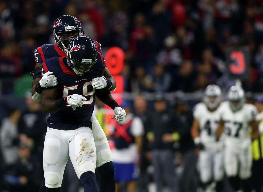 Houston Texans inside linebacker Benardrick McKinney (55) congratulates outside linebacker Whitney Mercilus (59) after Mercilus sacked Oakland Raiders quarterback Connor Cook (8) on a third down during the third quarter of an AFC Wild Card Playoff game at NRG Stadium Saturday, Jan. 7, 2017, in Houston. Photo: Jon Shapley, Houston Chronicle / © 2015  Houston Chronicle