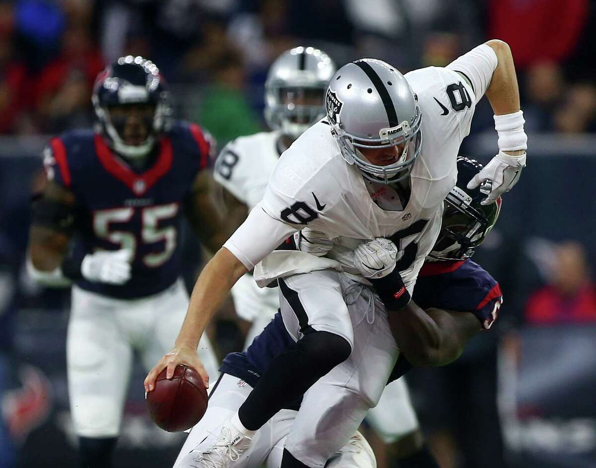 Oakland Raiders quarterback Connor Cook (8) is sacked by Houston Texans outside linebacker Whitney Mercilus (59) on a third down during the third quarter of an AFC Wild Card Playoff game at NRG Stadium Saturday, Jan. 7, 2017, in Houston.