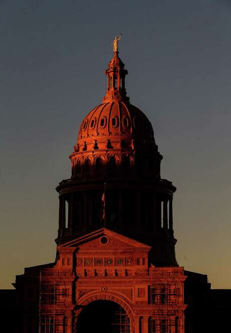 The Texas Capitol radiates in the setting sun, as it has for all 128 years of its existence in Austin. But the Texas granite has never looked better after an extensive exterior cleaning project. Photo: Jon Shapley, Staff / © 2015  Houston Chronicle
