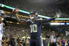 Wide receiver Paul Richardson of the Seahawks celebrates after making a one-handed touchdown catch against the Detroit Lions at CenturyLink Field on January 7, 2017 in Seattle.
