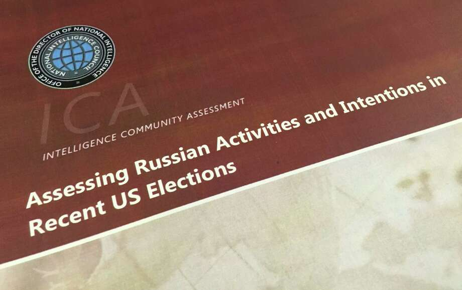 A part of the declassified version Intelligence Community Assessment on Russia's efforts to interfere with the U.S. political process is photographed in Washington, Friday, Jan. 6, 2017. Russian President Vladimir Putin ordered a campaign to influence the American presidential election in favor of electing Donald Trump, according to the report issued by U.S. intelligence agencies. The unclassified version was the most detailed public account to date of Russian efforts to interfere with the U.S. political process, with actions that included hacking into the email accounts of the Democratic National Committee and individual Democrats like Hillary Clinton's campaign chairman John Podesta. (AP Photo/Jon Elswick) ORG XMIT: WX116 Photo: Jon Elswick / AP