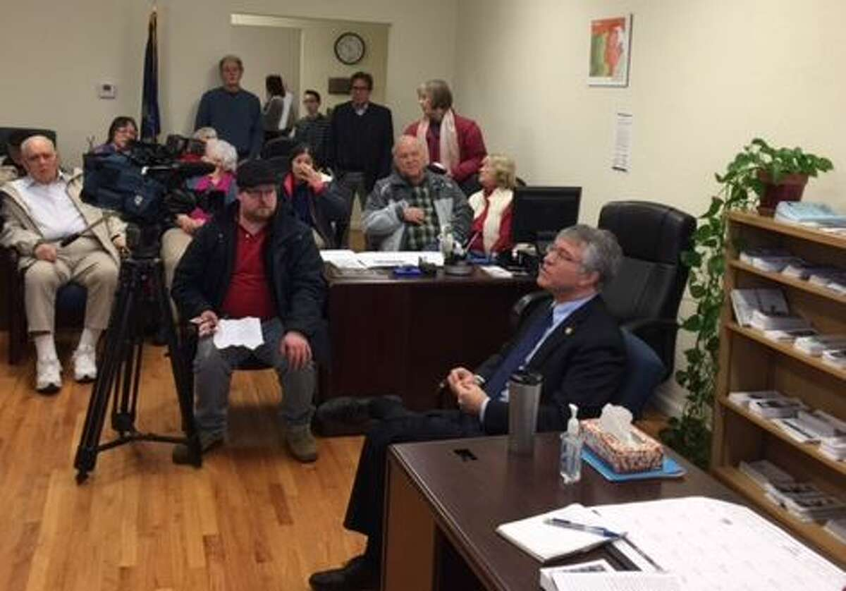 Assemblyman Phil Steck, right foreground, meets with constituents in his Schenectady office on Saturday, Jan. 7, 2017. (Rick Karlin/Times Union)