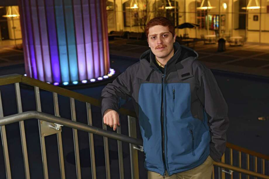 University at Albany junior Adel Muhi, who is studying computer engineering and is working to put himself through college stands next to the fountain at the college on Thursday, Jan. 6, 2017 in Albany, N.Y. (Lori Van Buren / Times Union) Photo: Lori Van Buren / 20039341A