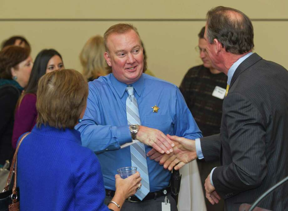 Montgomery County Sheriff Rand Henderson, center, visits with State Board of Education member Barbara Cargill, left, and Conroe ISD Superintendent Don Stockton during an appreciation reception for elected officials at the Conroe/Lake Conroe Chamber of Commerce building Thursday, Jan. 5, 2017, in Conroe. Thirty elected officials and representatives attended the event. Photo: Jason Fochtman, Staff Photographer / Houston Chronicle