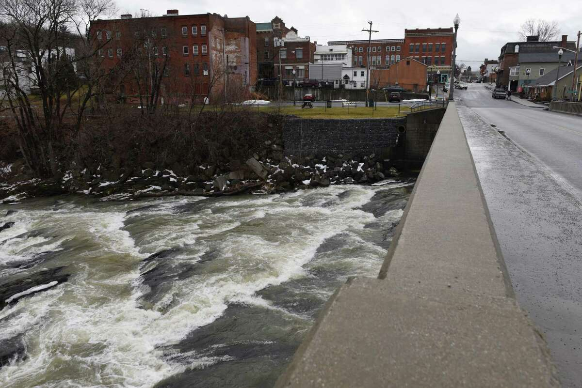The Hoosic River flows under Church Street on Wednesday, Jan. 4, 2017, in Hoosick Falls, N.Y. (Will Waldron/Times Union)
