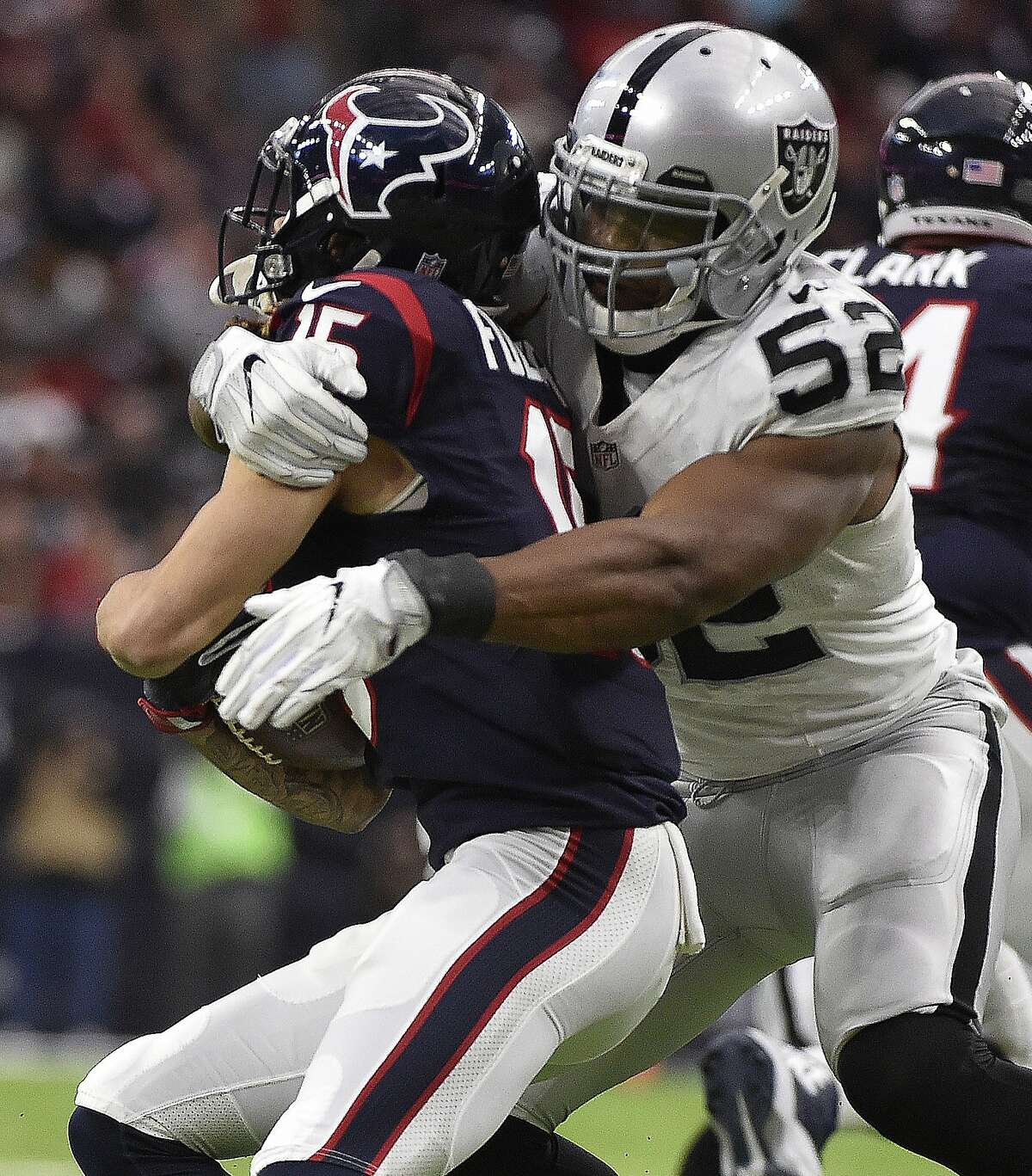 Oakland Raiders defensive end Khalil Mack (52) tackles Houston Texans wide receiver Will Fuller (15) during the first half of an AFC Wild Card NFL game Saturday, Jan. 7, 2017, in Houston. (AP Photo/Eric Christian Smith)