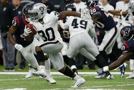 Corrected Version HOUSTON, TX - JANUARY 07:  Jalen Richard #30 of the Oakland Raiders carries the ball during the first half of the AFC Wild Card game against the Houston Texans at NRG Stadium on January 7, 2017 in Houston, Texas.  (Photo by Bob Levey/Getty Images)