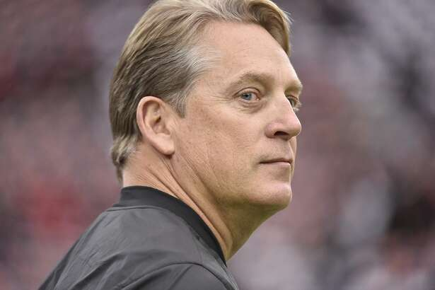 Oakland Raiders head coach Jack Del Rio walks the turf before the first half of an AFC Wild Card NFL game between the Houston Texans and the Oakland Raiders, Saturday, Jan. 7, 2017, in Houston. (AP Photo/Eric Christian Smith)