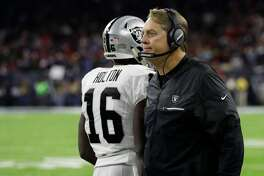 Oakland Raiders head coach Jack Del Rio speaks with Oakland Raiders quarterback Connor Cook (8) after a touchdown against the Houston Texans during the second half of an AFC Wild Card NFL football game Saturday, Jan. 7, 2017, in Houston. (AP Photo/Eric Gay)