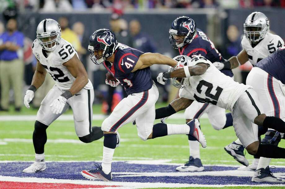 HOUSTON, TX - JANUARY 07: Jonathan Grimes #41 of the Houston Texans carries the ball against the Oakland Raiders in the AFC Wild Card game at NRG Stadium on January 7, 2017 in Houston, Texas.  (Photo by Thomas B. Shea/Getty Images) Photo: Thomas B. Shea, Stringer / Getty Images / 2017 Getty Images