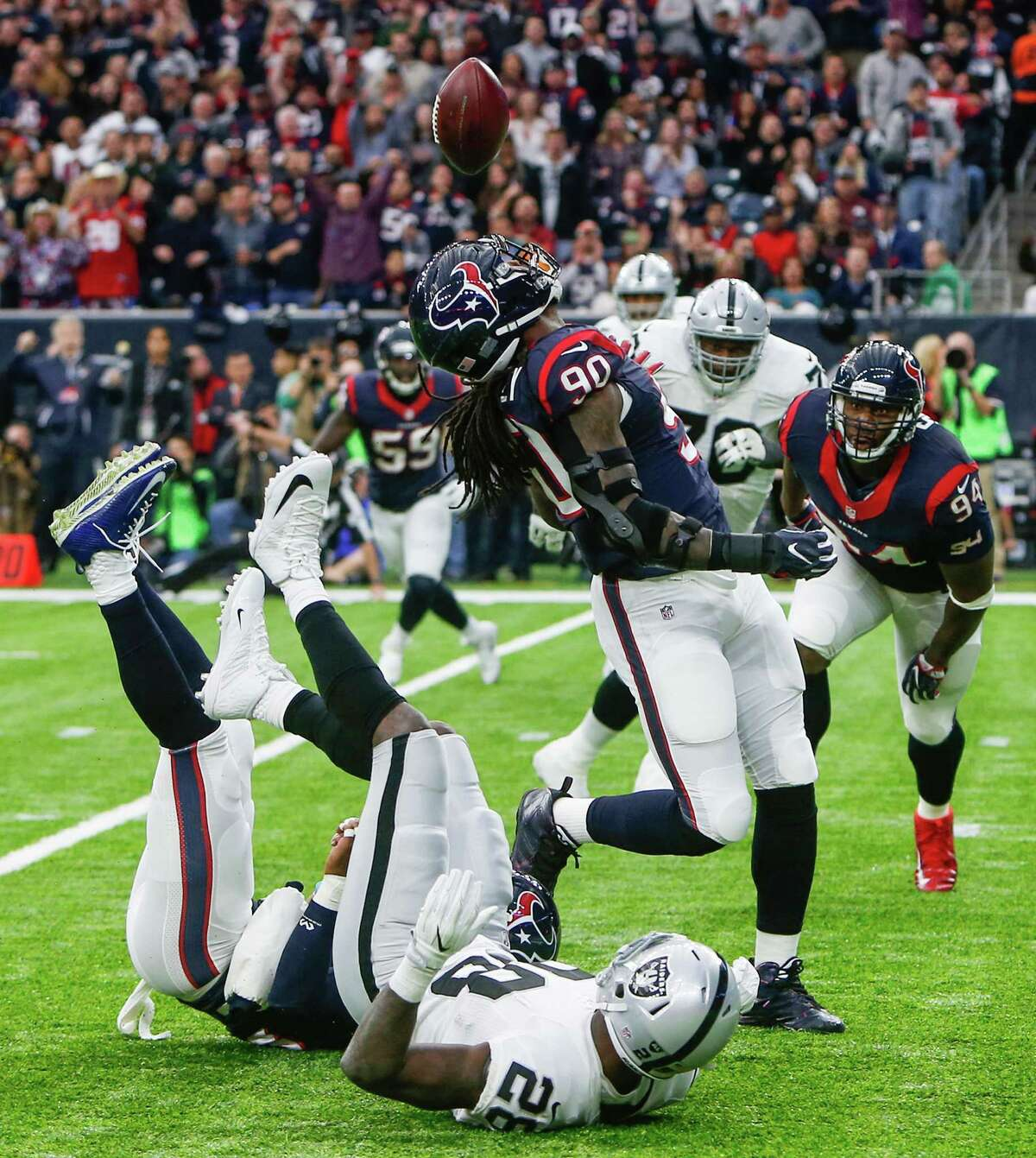 Houston Texans defensive end Jadeveon Clowney (90) intercepts a pass by Oakland Raiders quarterback Connor Cook during the first quarter of an AFC Wild Card Playoff game at NRG Stadium on Saturday, Jan. 7, 2017, in Houston. ( Brett Coomer / Houston Chronicle )